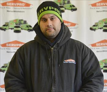 Crew Chief Josh poses in front of our SERVPRO backdrop